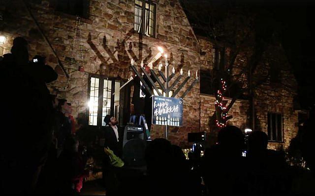 Members of ZBT fraternity of Penn State light their menorah on the first night of Hannukah, December 2, 2018. (Facebook screenshot)