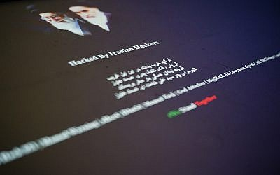 """The vandalized home page of a Saudi website displays Farsi-language slogans and the words """"Hacked by Iranian Hackers"""" in this Thursday, June 8, 2017 photograph taken in London. As tensions flare between Saudi Arabia, Qatar, Iran and their allies, reports of hacking are emerging across the Gulf. (AP Photo/Raphael Satter)"""