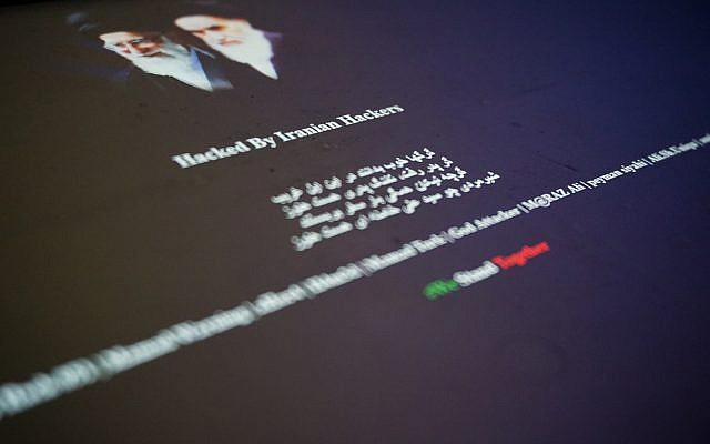 "The vandalized home page of a Saudi website displays Farsi-language slogans and the words ""Hacked by Iranian Hackers"" in this Thursday, June 8, 2017 photograph taken in London. As tensions flare between Saudi Arabia, Qatar, Iran and their allies, reports of hacking are emerging across the Gulf. (AP Photo/Raphael Satter)"