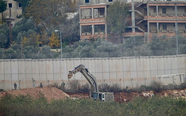 An Israeli military digger works on the border with Lebanon in the northern Israeli town of Metulla, December 4, 2018. (AP Photo/Ariel Schalit)