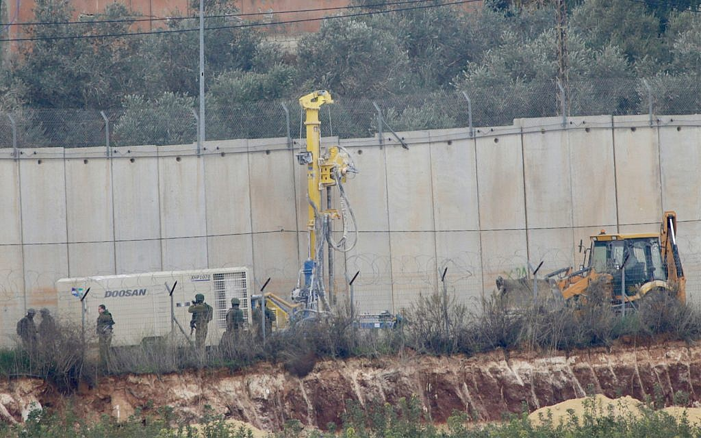 Israeli military digger works on the border with Lebanon in the northern Israeli town of Metula, Tuesday, Dec. 4, 2018. (AP Photo/Ariel Schalit)