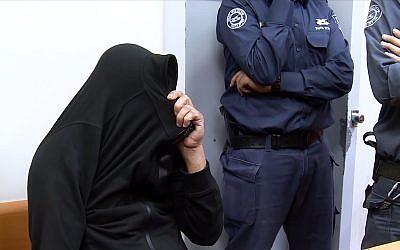 A suspect in the El Al drug smuggling case appears in court, November 26, 2018. (Screenshot/Ynet news)