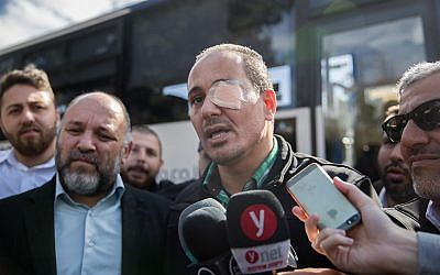 Nidal Fakih, who was attacked last week while driving a bus last week, speaks to the media during a protest of Kavim bus drivers against violence directed at them near the Knesset, December 17, 2018. Photo by Yonatan Sindel/Flash90