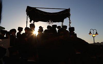 Hasidic Jewish men celebrating a wedding in an illustrative image. (Yaakov Lederman/Flash90)