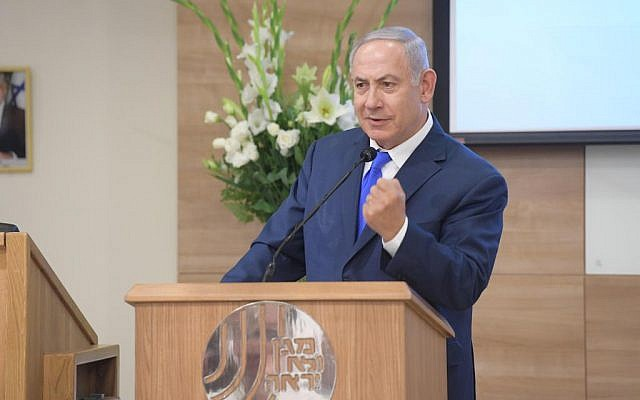 Prime Minister Benjamin Netanyahu speaks at an awards ceremony at the Shin Bet's headquarters in Tel Aviv honoring agents who excelled in intelligence operations in 2017 and 2018, on December 4, 2018. (Amos Ben Gershom/GPO)