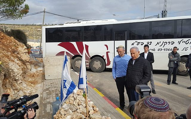 Prime Minister Benjamin Netanyahu (R) visits Givat Assaf Junction with Beit El Local Council chairman Shai Alon where two IDF soldiers were killed in a terror attack, on December 18, 2018. (Beit El Local Council)