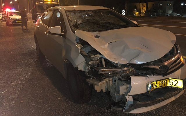 A damaged car is seen after it struck an Israeli combat soldier on Route 232 in southern Israel on December 19, 2018. (Israel Police)