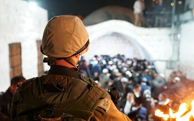Illustrative: Israeli soldiers escort hundreds of Jewish worshippers to the Joseph's Tomb holy site in Nablus in the northern West Bank on December 10, 2018. (Israel Defense Forces)