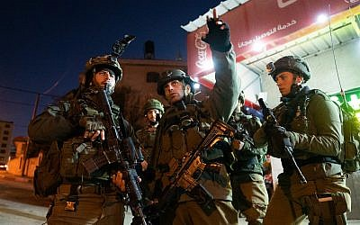 Israeli troops search for the terrorists who committed a shooting attack on a bus stop outside the Ofra settlement in the West Bank, near Ramallah, in which seven Israelis were injured, including a pregnant woman, on December 9, 2018. (Israel Defense Forces)