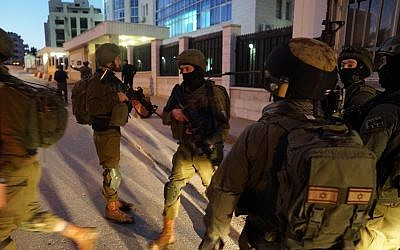In this undated photograph, Israeli troops search for the terrorists who committed a shooting attack on a bus stop outside the Ofra settlement in the West Bank, near Ramallah, in which seven Israelis were injured, including a pregnant woman, on December 9, 2018. (Israel Defense Forces)