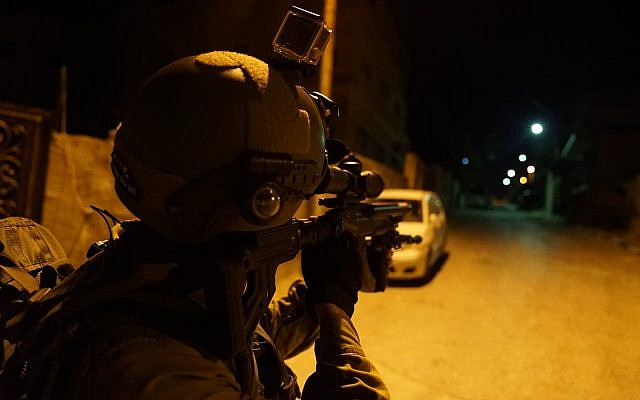 In this undated photograph, Israeli troops search for the terrorist who committed a brutal shooting attack in the Barkan industrial park in the northern West Bank in which two Israelis were killed on October 7, 2018. (Israel Defense Forces)