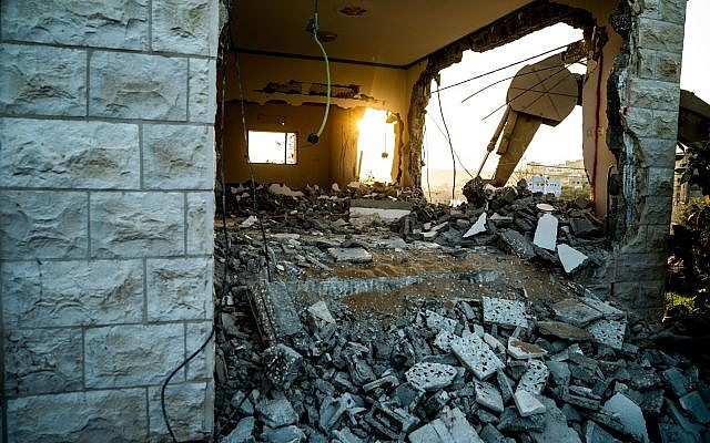 The Israeli military on December 17, 2018, partially destroys the home of Ashraf Na'alowa, a Palestinian terrorist who killed two Israelis and injured a third in a shooting attack in the Barkan industrial zone two months prior. (Israel Defense Forces)