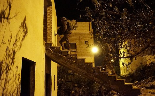Israeli soldiers conduct raids in the West Bank village of Kobar on December 31, 2018, in search of Palestinian terrorists who committed a deadly shooting attack outside the Givat Assaf outpost earlier in the month. (Israel Defense Forces)