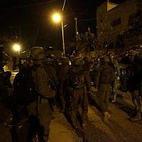 Israeli soldiers conduct raids in West Bank village of Kobar on December 31, 2018, in search of Palestinian terrorist who committed deadly shooting attack outside the Givat Assaf outpost earlier in the month. (Israel Defense Forces)