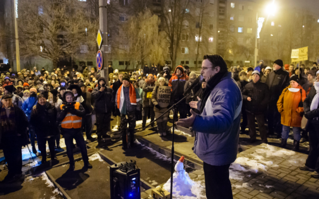 MP Adam Mirkoczky, chairman of the oppositional party Jobbik's Heves county office, delivers his speech during the rally held against the government in Eger, Hungary, Wednesday, Dec. 19, 2018. (Peter Komka/MTI via AP)