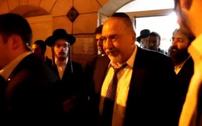 Yisrael Beytenu head Avigdor Liberman leaves the home of slain IDF soldier Sgt. Yosef Cohen, December 19, 2018 (Channel 10 screenshot)