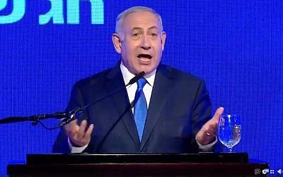 Prime Minister Benjamin Netanyahu speaks at a Likud Hanukkah event on December 2, 2018 (screen capture: Facebook)