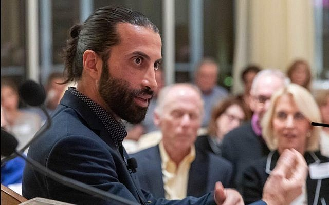 (Above and main image at top of article:) Mosab Hassan Yousef addresses an AFMDA event in Florida, December 2018 (Courtesy)