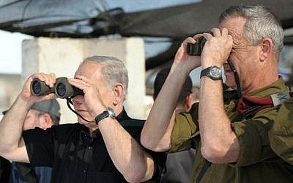 Prime Minister Benjamin Netanyahu, left, and then-IDF chief of staff Lt. Gen. Benny Gantz watch a military exercise of the army's Golani Brigade on the Golan Heights, September 11, 2012. (Avi Ohayon/GPO/Flash90)