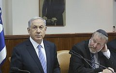 Prime Minister, Benjamin Netanyahu, left, and then-cabinet secretary Avichai Mandelblit at a cabinet meeting on January 4, 2015. (Marc Israel Sellem/Pool/Flash90)