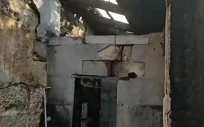 The burned-out remains of a small dwelling near the Church of Mary Magdalene on the slopes of the Mount of Olives, engulfed in a fire on December 23, 2018, that claimed the life of 91-year-old nun Silva Maria Selaso. (Kan screen capture)