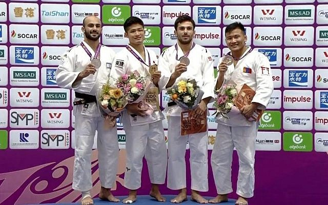 Israeli judoka Baruch Shmailov (far left), after receiving the silver medal at the Masters tournament in Guangzhou, China, December 15, 2018 (Israel Judo Association)