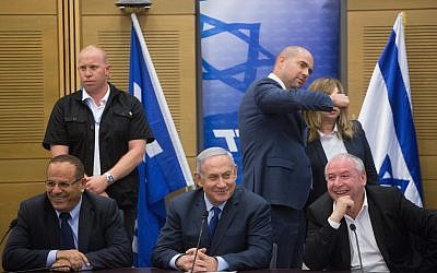 Prime Minister Benjamin Netanyahu with coalition head and Likud parliament member David Amsalem (R) and Minister of Communication Ayoub Kara at a Likud party faction meeting at the Knesset on May 7, 2018. (Miriam Alster/Flash90)