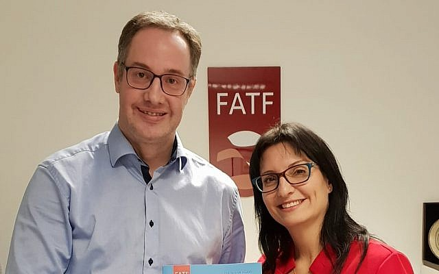 Executive secretary of the Financial Action Task Force David Lewis (left) poses with Dr. Shlomit Wagman, head of the Israel Money Laundering and Terror Financing Prohibition Authority on the occasion of Israel's acceptance as a member of the FATF, Tel Aviv, December 10, 2018. (Justice Ministry)