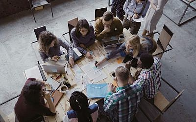 Workers in a startup (Vadim_Key; iStock by Getty Images)