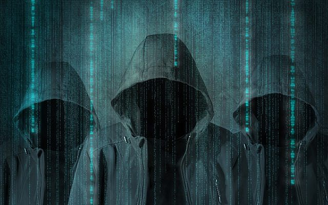 An illustrative image of hackers/cybersecurity (natasaadzic; iStock by Getty Images)