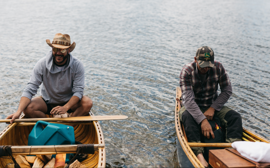 Anthony Rose, left, goes canoeing on Obabika Lake, about 300 miles north of his hometown of Toronto, as part of a group camping trip. (Courtesy Kayla Rocca Photography)