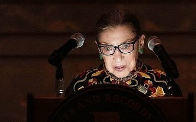 US Supreme Court Justice Ruth Bader Ginsburg speaks during a naturalization ceremony at the rotunda of the National Archives in Washington, DC, Dec. 14, 2018 (Alex Wong/Getty Images via JTA)