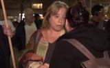Iris Hajbi, mother of terror victim Ziv Hajbi, at a rally in Tel Aviv on December 15, 2018 (Channel 10 screenshot)