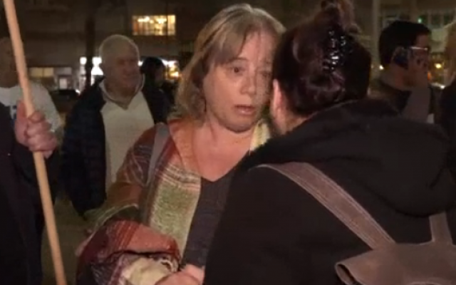 Iris Hajbi, mother of terror victim Ziv Hajbi, at a rally in Tel Aviv on December 15, 2018 (Channel 10 screenshot)