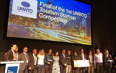 The winners and WTO, Globalia, and Refundit representatives on stage in Madrid on January 23, 2019 (Refundit)