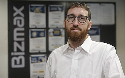 Yitzik Crombie, the CEO of Israeli start-up Bizmax, poses at the company's offices in Jerusalem, on November 21 2018. (MENAHEM KAHANA/AFP)