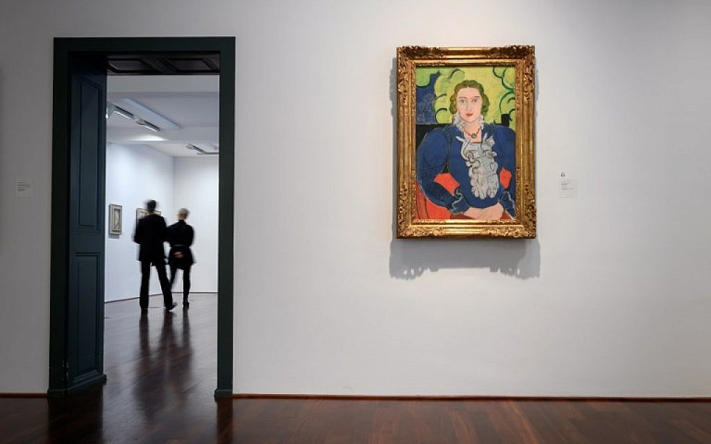 """A painting by Henri Matisse entitled """"The Blue Blouse"""" is seen at the Kunstmuseum Bern in Bern, Switzerland on December 4, 2018 (Fabrice COFFRINI / AFP)"""