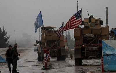A line of US military vehicles drive through a checkpoint of the Internal Security Forces in Manbij as they head to their base on the outskirts of the northern Syrian city on December 30, 2018. (Delil SOULEIMAN/AFP)