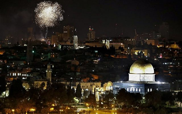 Fireworks explode over Jerusalem's Old City and the Dome of the Rock mosque during New Year celebrations, on January 1, 2019. (Photo by AHMAD GHARABLI / AFP)