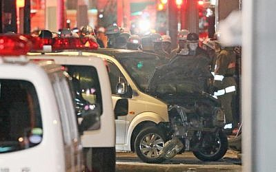 Police inspect a car whose driver rammed his vehicle into crowds on Takeshita street in Tokyo early January 1, 2019. (JIJI PRESS / JIJI PRESS / AFP)
