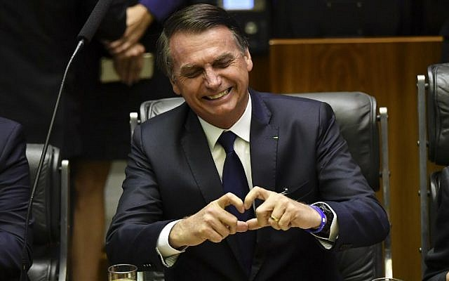 Brazil's President-elect Jair Bolsonaro gestures at the National Congress in Brasilia before he is sworn in as Brazil's new president on January 1, 2019. (Nelson Almeida/AFP)