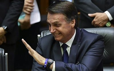 Newly sworn-in Brazilian President Jair Bolsonaro gestures during his inauguration ceremony at the National Congress in Brasilia on January 1, 2019. (Nelson Almeida/AFP)