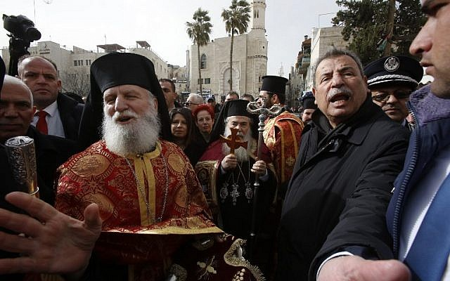Jerusalem's Greek Orthodox Patriarch Theophilos III, center, arrives at the Church of the Nativity in the West Bank town of Bethlehem, to celebrate the Christmas mass with his community, on January 6, 2019. (Musa Al SHAER/AFP)
