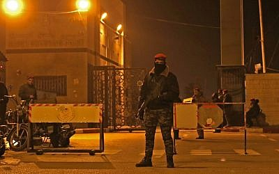 Palestinian security forces loyal to Hamas stand guard at the Rafah border crossing with Egypt, on January 7, 2019. (Said Khatib/AFP)