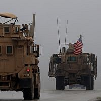 In this photo from December 30, 2018, shows a line of US military vehicles in Syria's northern city of Manbij. (Delil Souleiman/AFP)