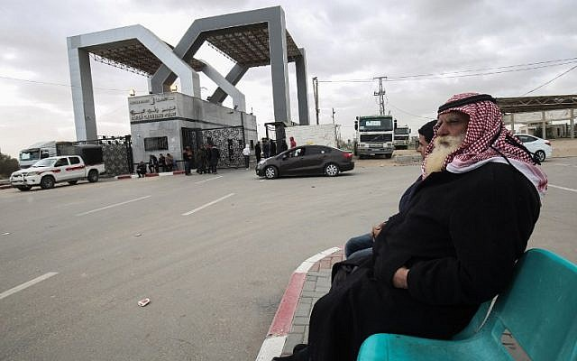 Palestinians sit waiting at the Rafah border crossing with Egypt, in the southern Gaza Strip, on January 8, 2019. (Said Khatib/AFP)