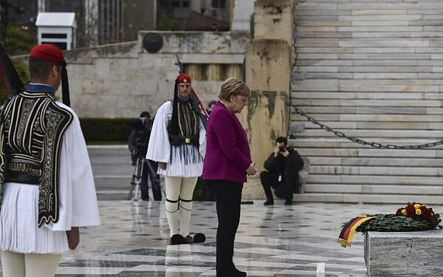 German Chancellor Angela Merkel pays tribute at the Tomb of the Unknown Soldier  in Athens on January 11, 2019 (Aris Messinis/AFP)