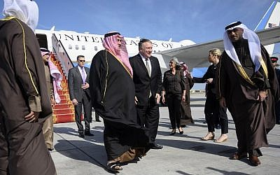 US Secretary of State Mike Pompeo (C-R) is greeted by Bahraini Foreign Minister Khalid bin Ahmed Al Khalifa (C-L) after arriving in Manama International Airport in Manama on January 11, 2019. (Andrew Caballero-Reynolds/Pool/AFP)