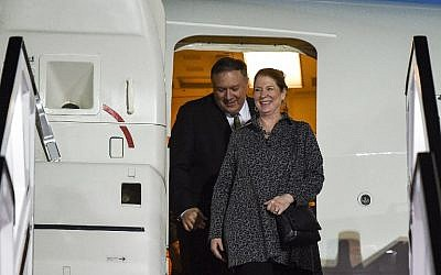 US Secretary of State Mike Pompeo, left, and his wife Susan disembark from their plane as they arrive at Abu Dhabi International Airport in Abu Dhabi on January 11, 2019. (Andrew Caballero-Reynolds/Pool/AFP)