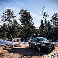A police car blocks the road where teenager Jayme Closs was found on January 11, 2019 in Gordon, Wisconsin. (Kerem Yucel/AFP)